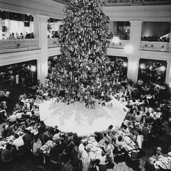 A large tree presides over dining tables at the Walnut Room in Chicago