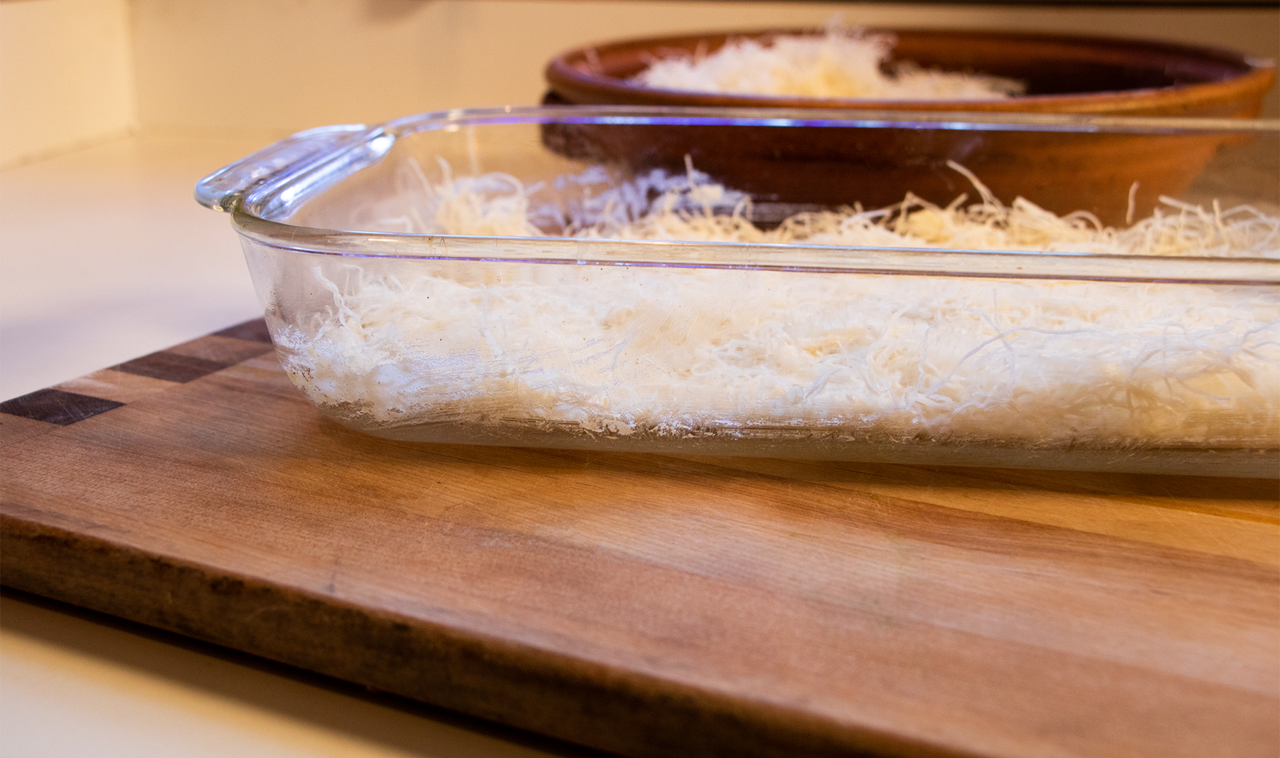 Pyrex baking tray with kataifi pressed into the bottom