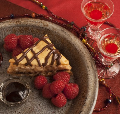 Chocolate Baklava and Organic Raspberries on a red background for Valentine's Day