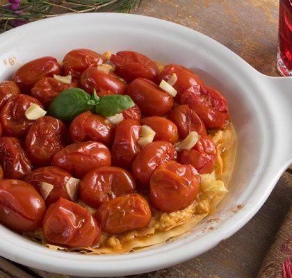 Roasted grape tomatoes on a crispy fillo tart