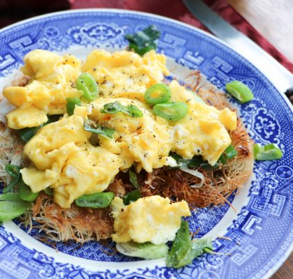 Scrambled eggs over a bed of scallions and kataifi
