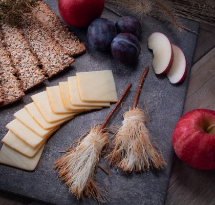 Edible witch broomsticks, decorate a platter with cheese and apples