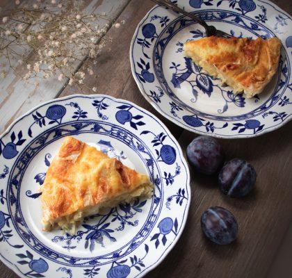 Two slices of bulgarian feta pie on plates, ready to eat.